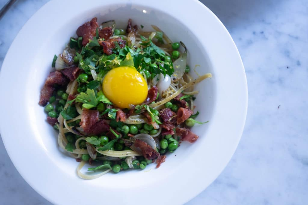 spring pasta with bacon, peas, and egg